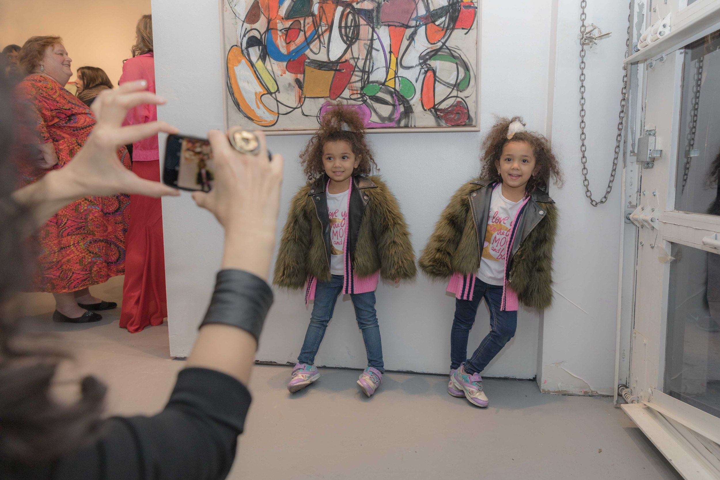 Twinning next to their favorite piece by Taher Jaoui