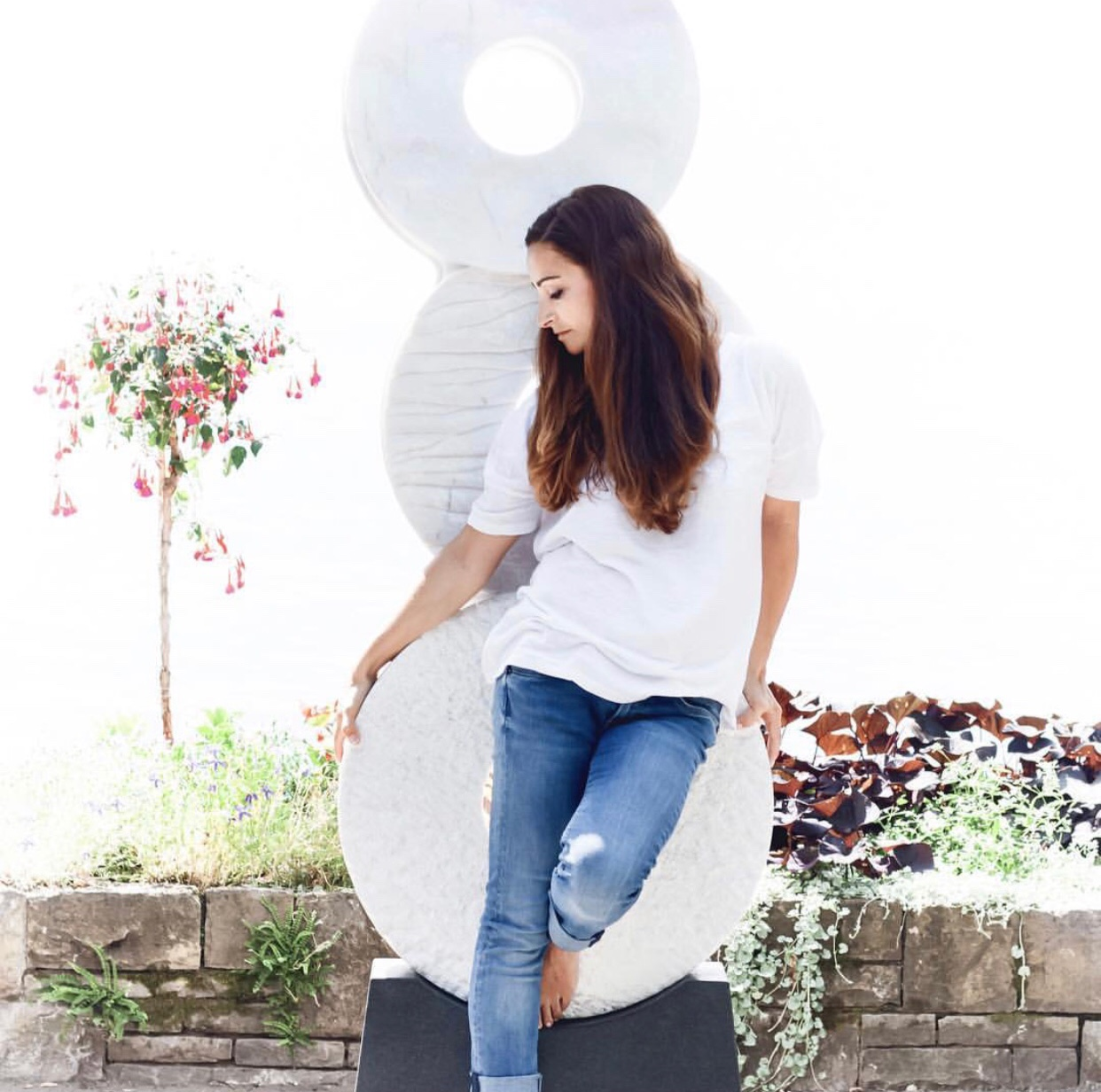 Alexia Weill with her signature circular stone sculptures. Image courtesy of the artist.