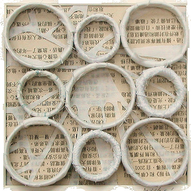 """Nine Circles   10"""" x 10"""" framed  mixed media fabric and paper  $70"""