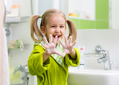 girl washing hands.jpg
