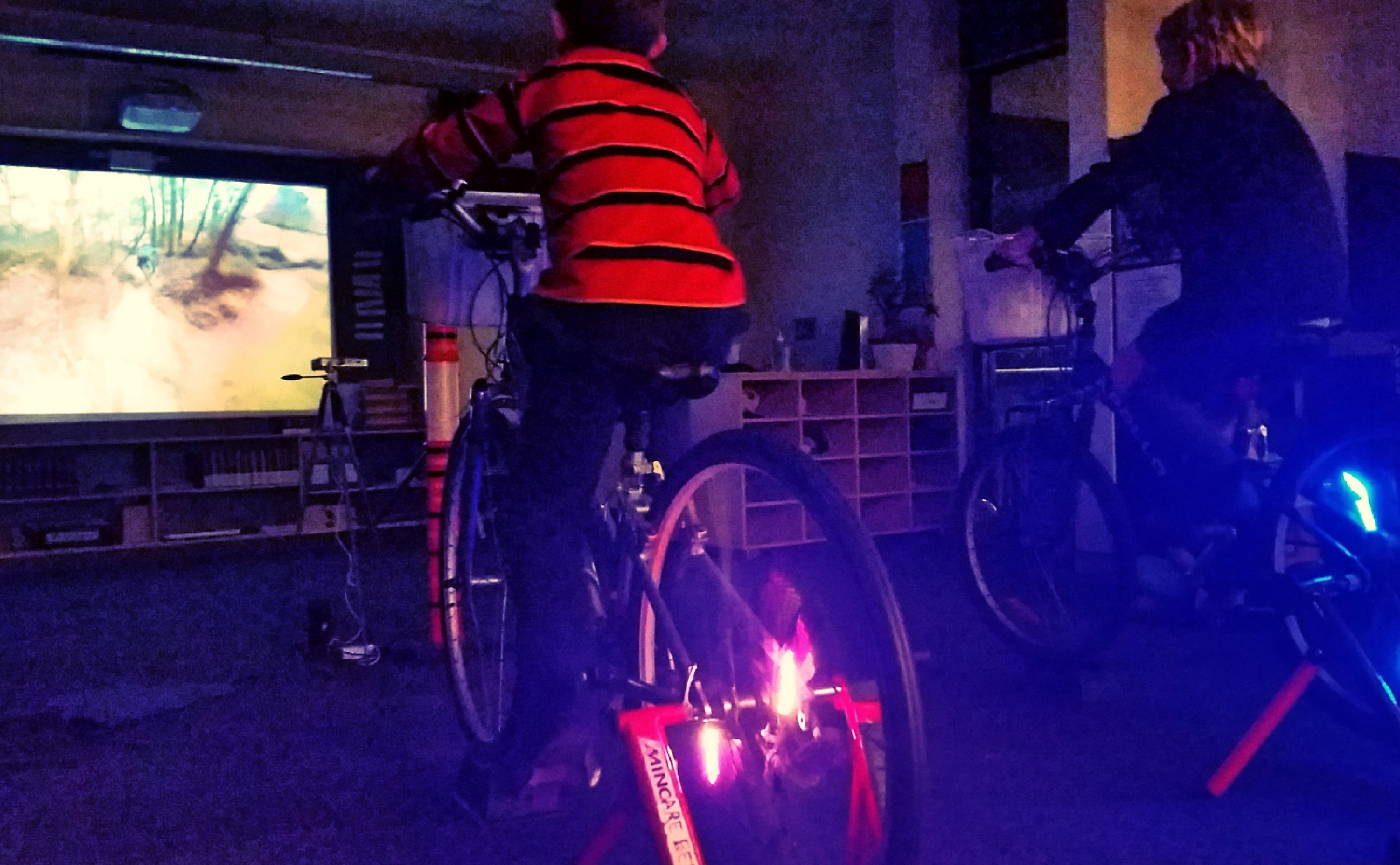 Bike powered VR mtn biking - Cyclists power the LED projector screening some of the best short mountain bike rides, filmed on helmet cameras