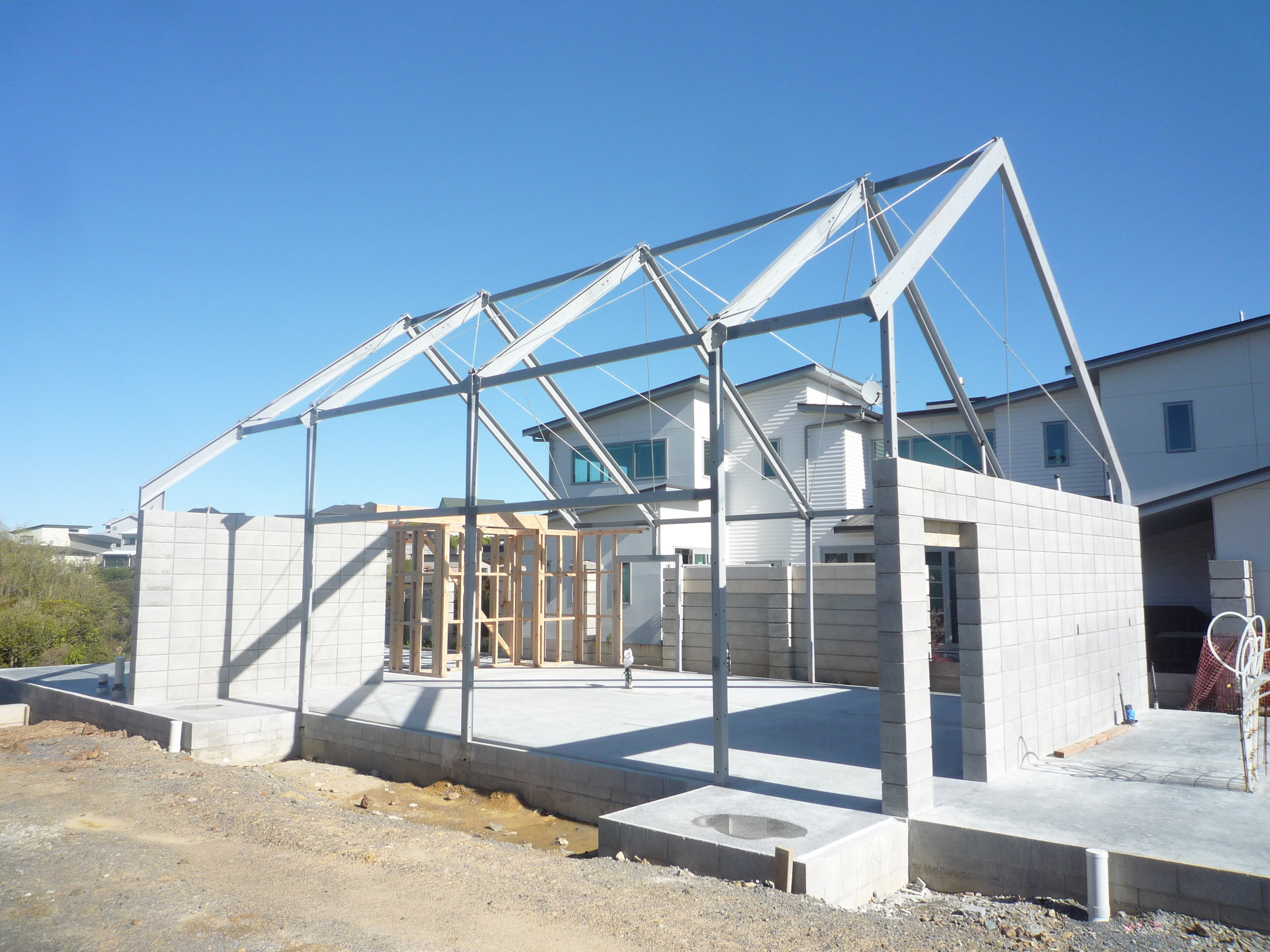 Mid-construction  - To create the large open spaces and high ceilings steel portal frames were used.