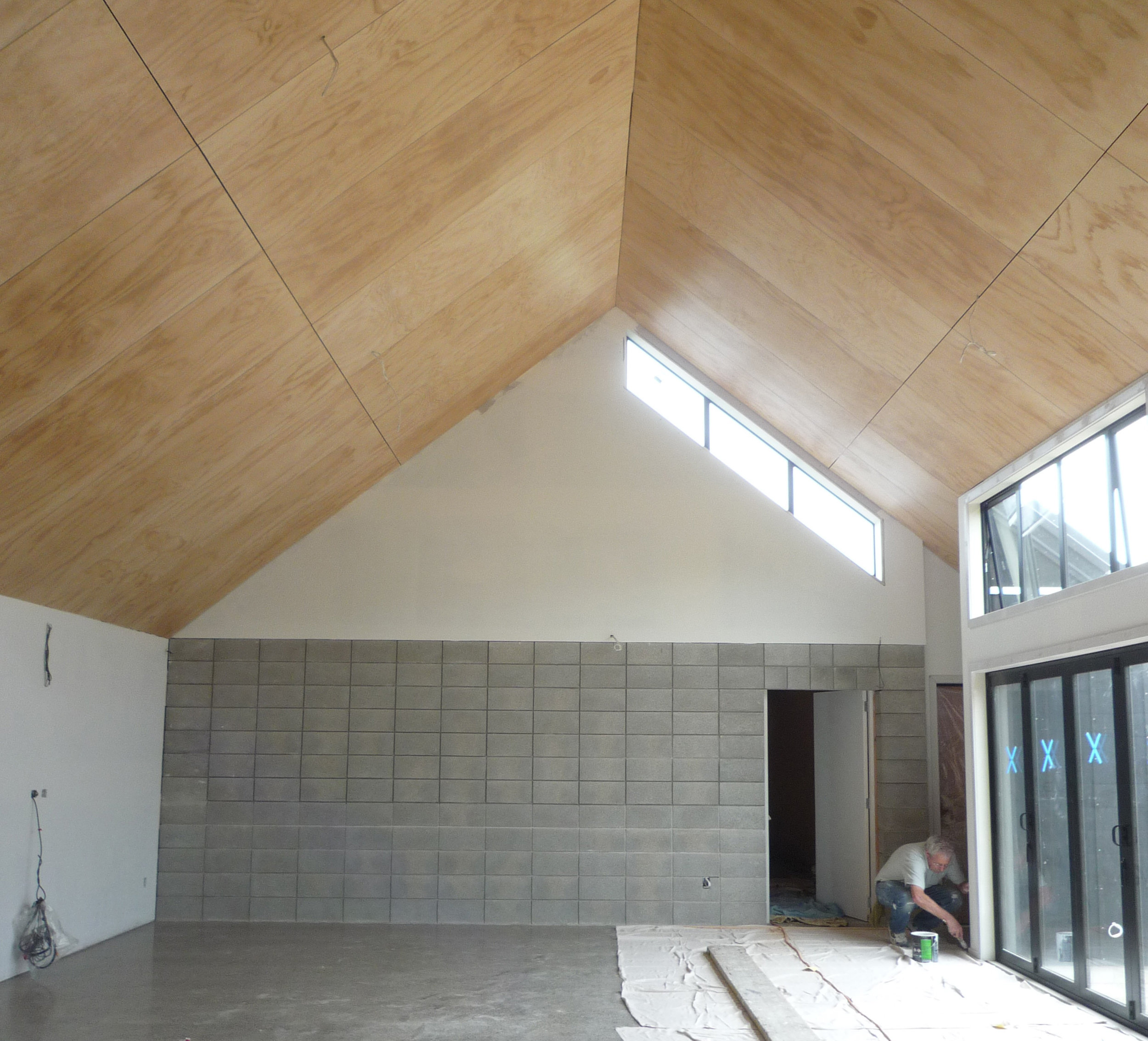 Mid-construction -  The polished concrete floor, concrete block walls, white walls, plywood ceilings and trims all compliment each other, creating a hard wearing, warm and stylish space.