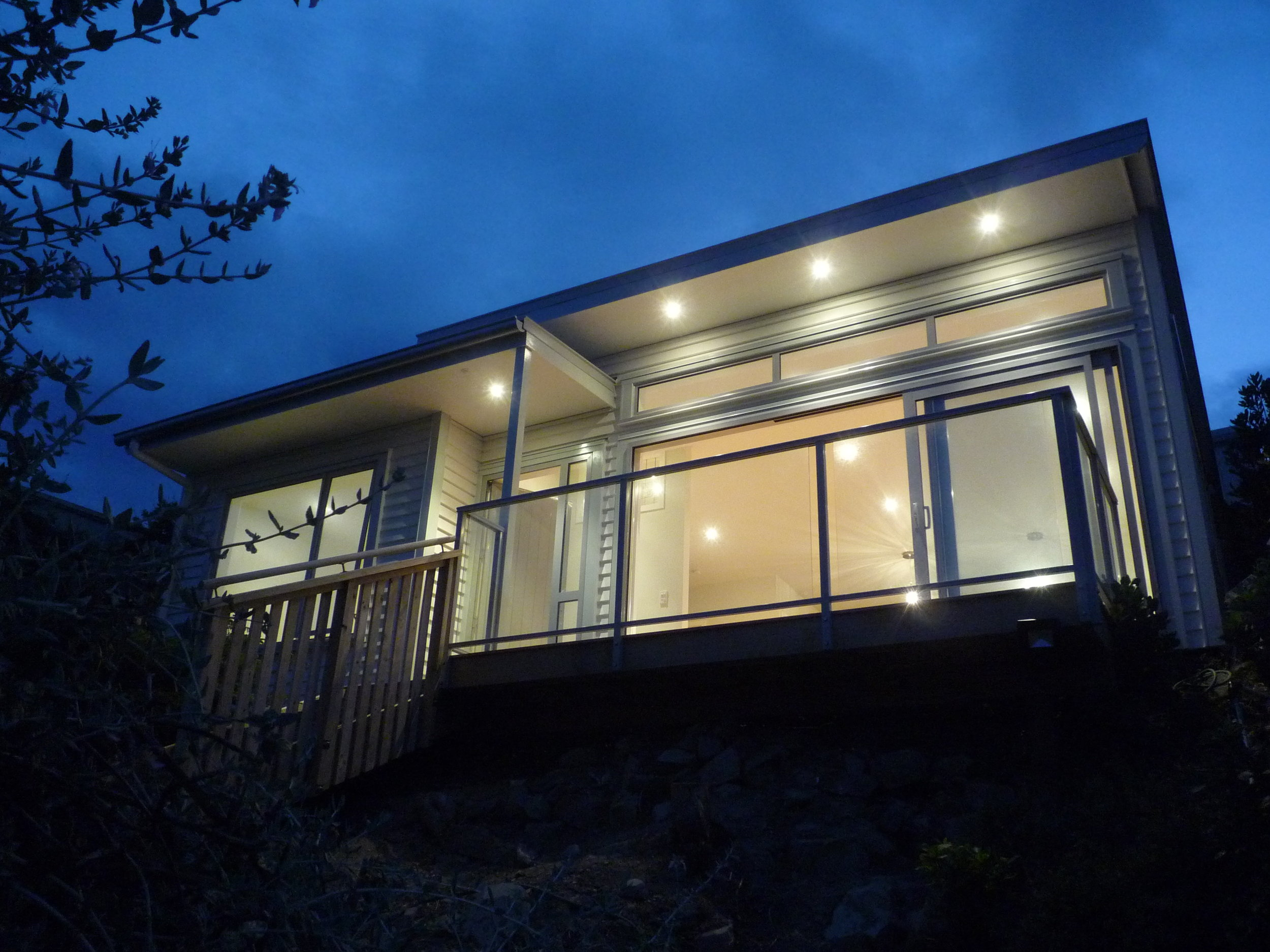 Roseneath New Build  - An existing sleepout at the top of a Roseneath property was mostly demolished to make way for this new 84m2 house, comprising 3 bedrooms, 1 bathroom and a sunny open space Living/Dining/Kitchen. The limited available space...  more