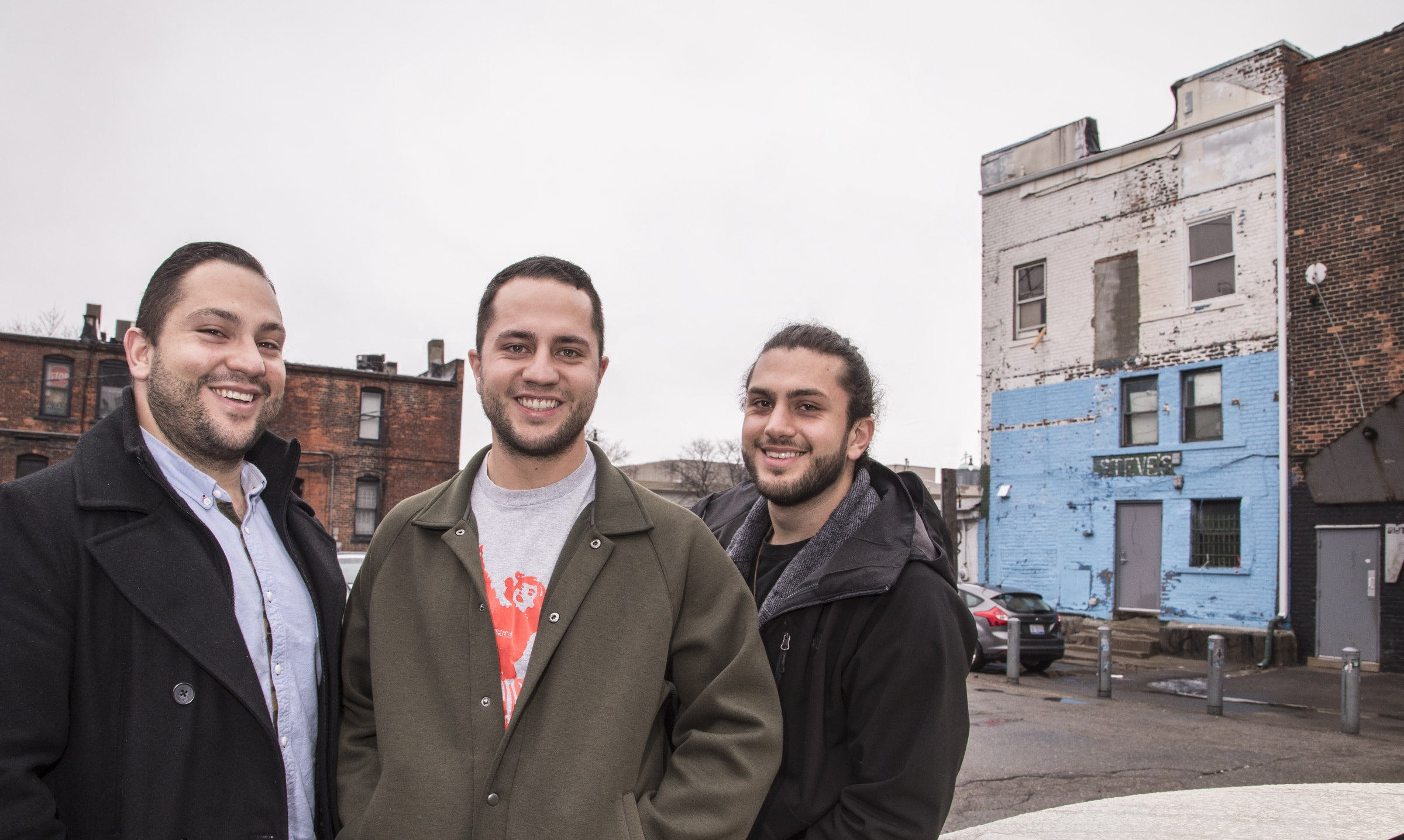 Moody (left), Zach and Malik Mattan at rear of The Elephant Room. An augmented reality mural (pictured below) is planned for the wall behind them.