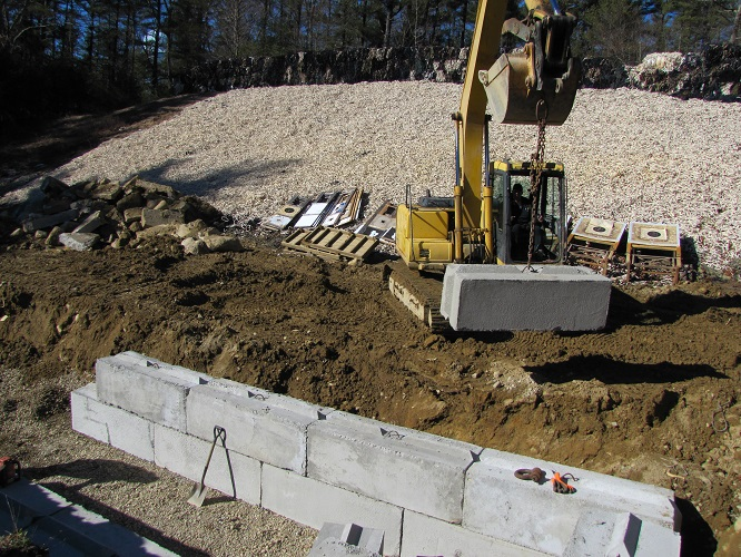 2/26/19: Work started on 2/25/19 with the removal of the original structure. Here, they are beginning to lay the new concrete block.
