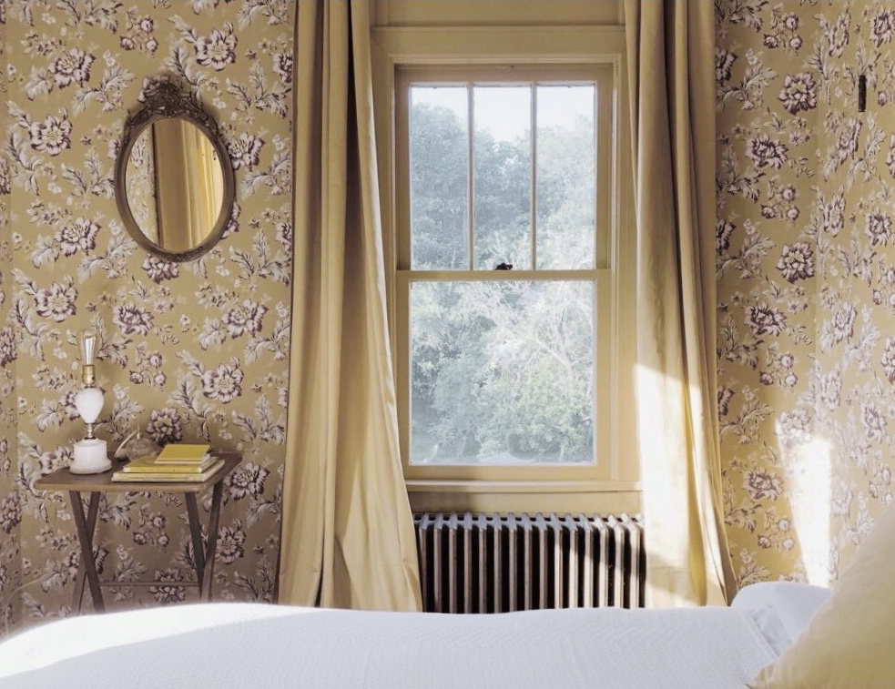 The yellow room is bathed in light and characterised by it's distinctive floral walls; a feature that that complements the views overlooking the garden on two sides. Waking up here is a dream, with birds singing outside and sunlight streaming through the gaps in the curtains.The room is approximately 90 sq feet, with a full bed, a walk in closet, and access to a shared bathroom. -