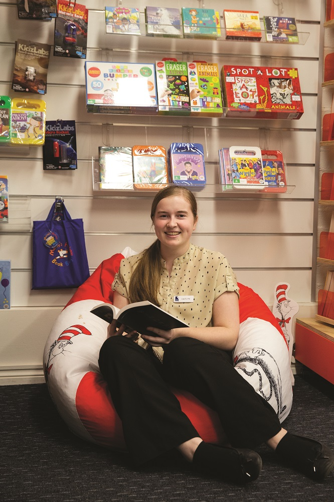 Trainee Caitlyn Keene taking a moment to read in a quiet spot.jpg