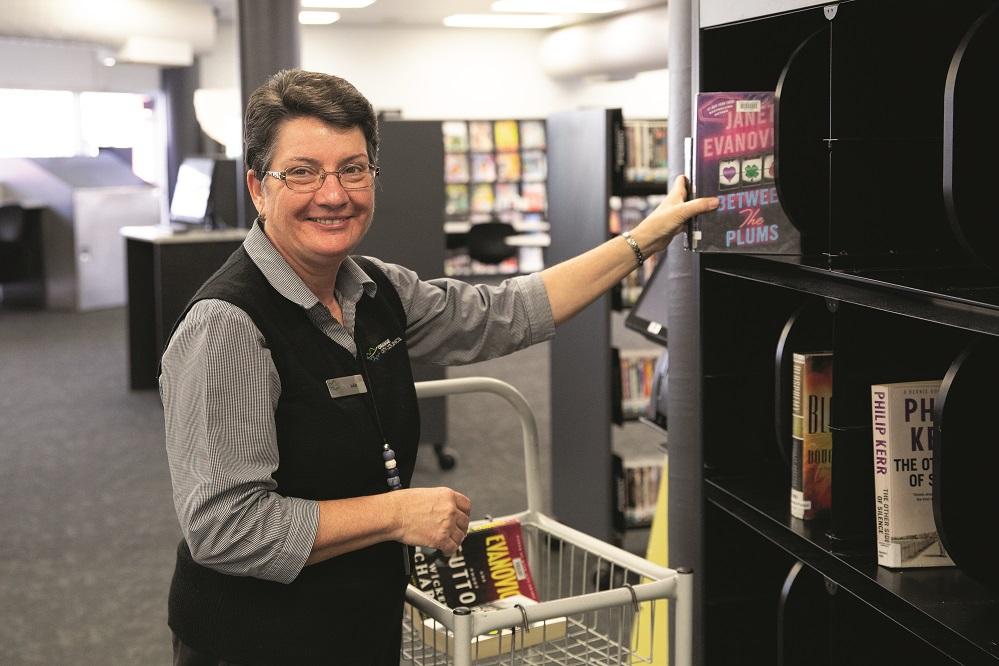 Julie Sykes organising the returned books.jpg