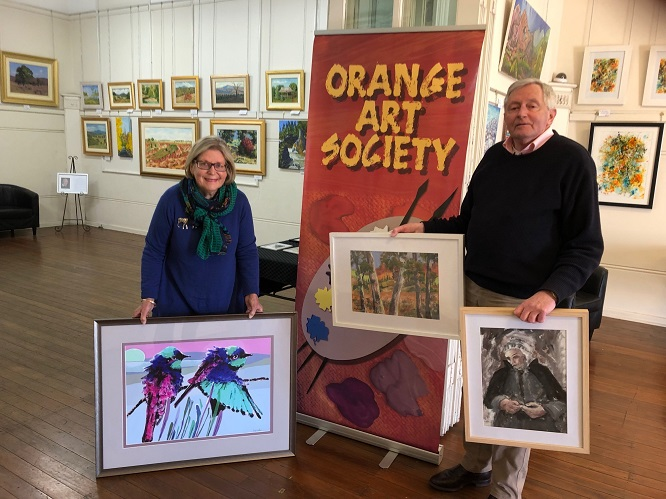 Maggie Rosso and Noel McCumstie sorting paintings for new exhibition.jpg