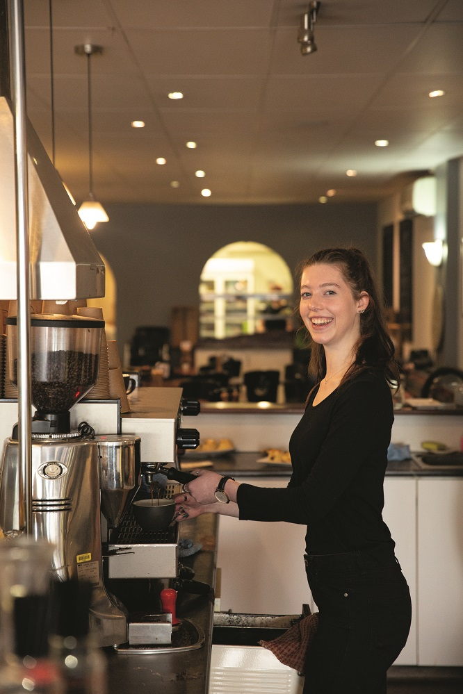 web_Waitress, Lauryn O'Shaughnessy trying out the coffee machine.jpg