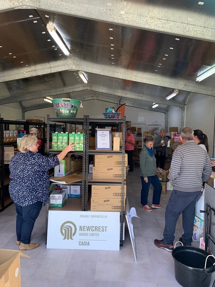 FoodCare Volunteers Getting the new shop ready.jpg