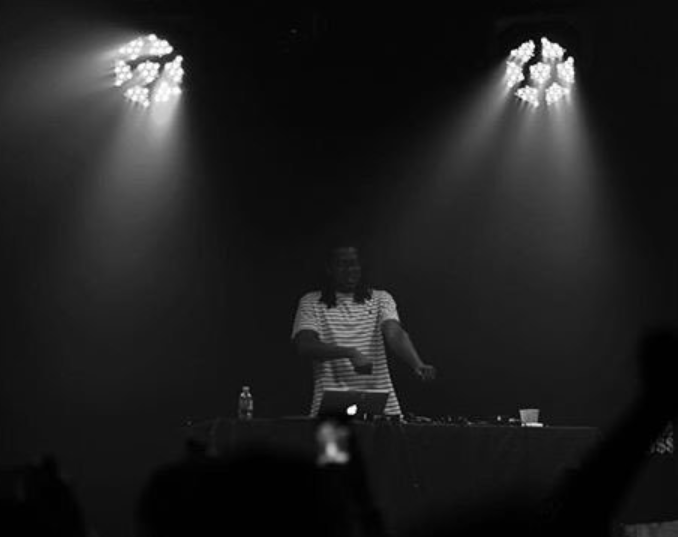 Above is a photo of Keyboard DJing at a Based world event.