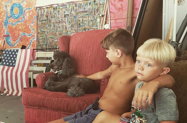 Hanging out, watching the rain  with my boys...and Shelby. . #july4th #4thofjuly #carync #raleighnc #hollyspringsnc #apexnc #durhamnc #chapelhill #fuquayvarina #charlottenc #greensboro #wilmingtonnc #americanflag #brothers #poodle #poodlesofinstagram #dog #mural #garage #ncphotographer