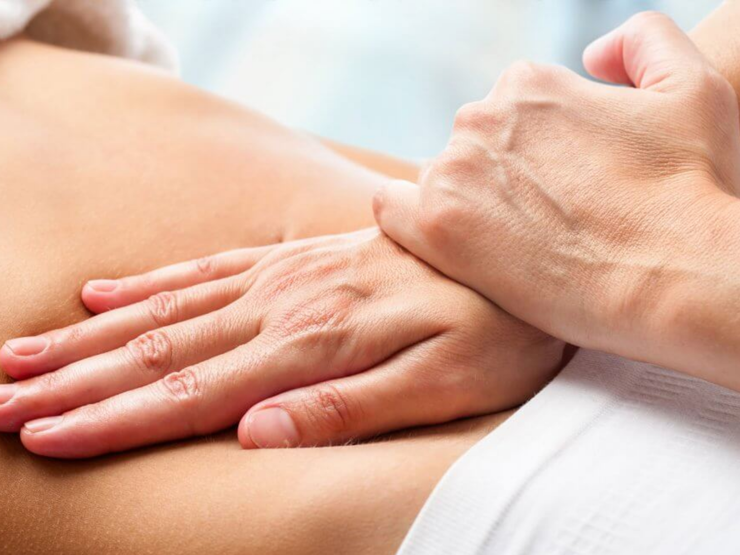 osteopaths hands treating patient, hereford