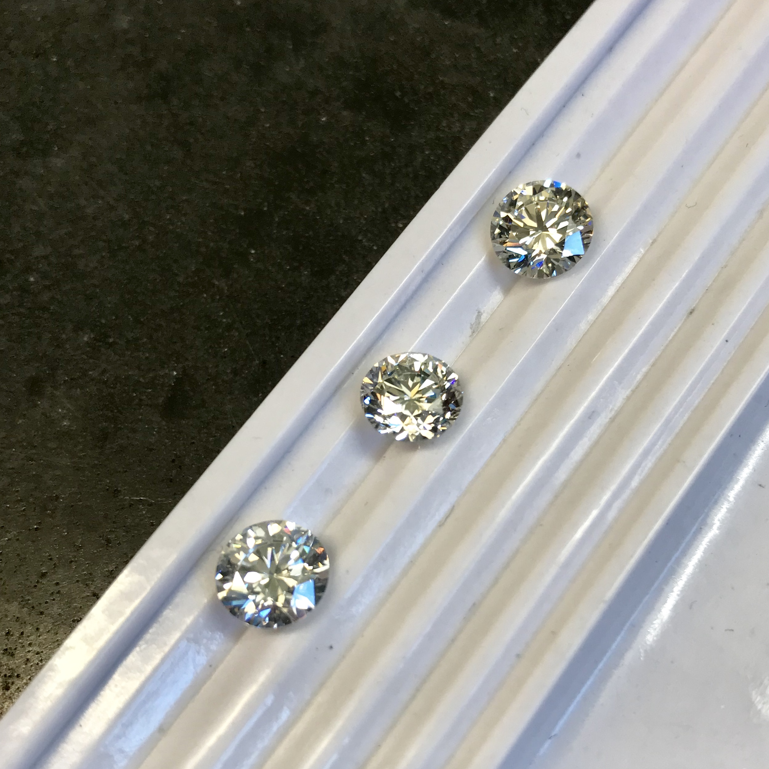 Stone selecting - Picking the best 2ct Diamond for a special pendant order.