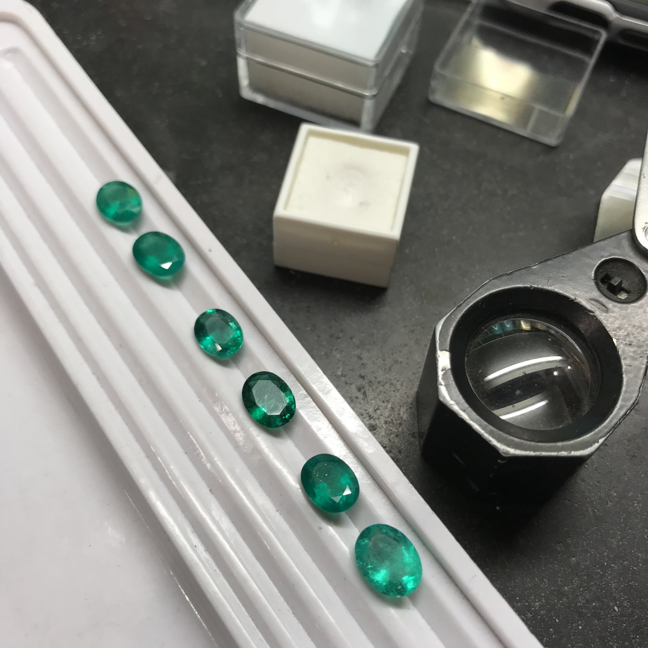 Stone selecting - Vivid green Emeralds sourced for a client commission. The birthstone for May, Emeralds can be more sort after than Diamonds.