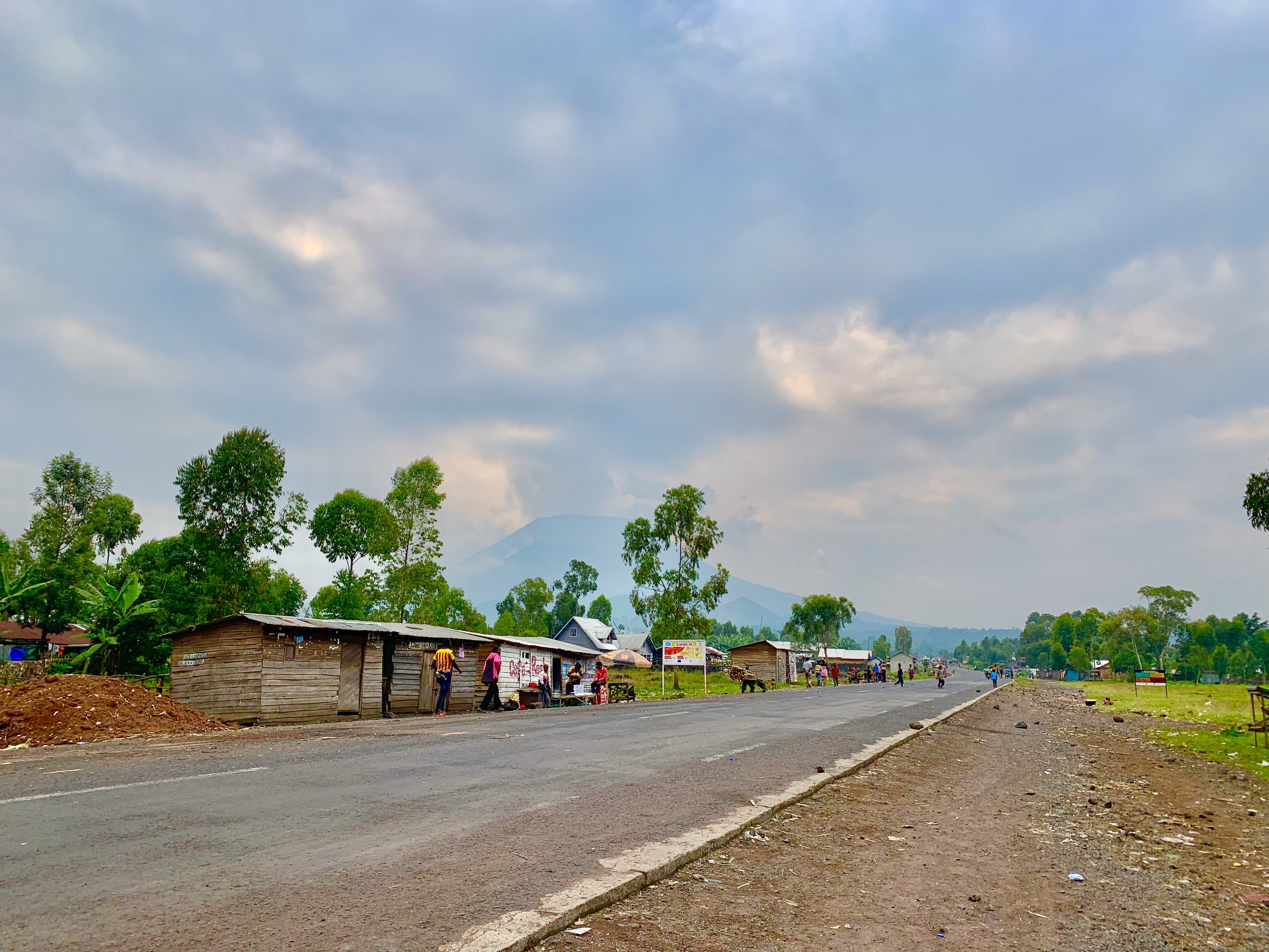 The checkpoint where we met our escorts into the park. You can Nyiragonog in the distance