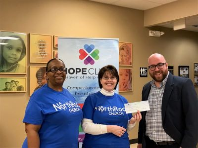 Kelly and Leah from North Rock Church present a check to Billy Kangas at Hope Clinic.