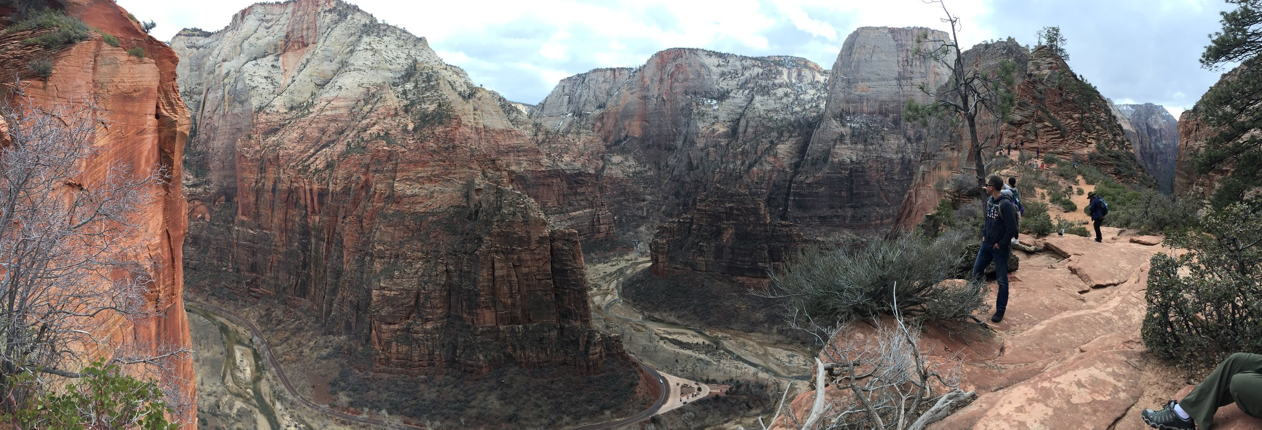 Halfway up Angels Landing. Greg takes in the breathtaking view, moments before we oblivious to the fact that he's about to meet the love of his life.