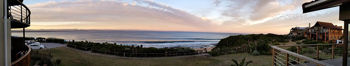 Jeffreys Bay, South Africa . This view from our balcony of and the best right hand point break in the world. When supertubes fires there is no place on earth that delivers such quality waves.