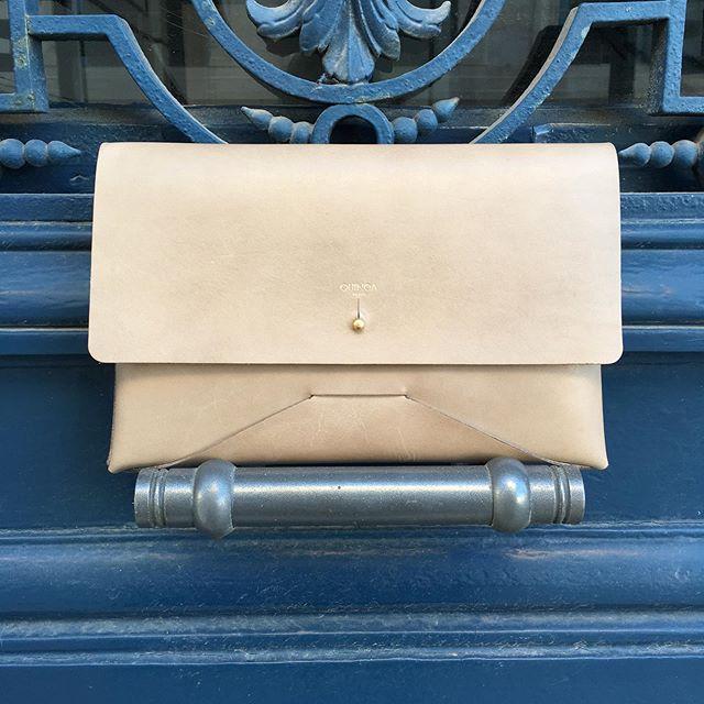 Our clutch bag Juliette posing on our door in Montmartre . . . . . . . . #leatherclutchbag  #vegtanleather  #parisianbrand  #madeinfrance🇫🇷