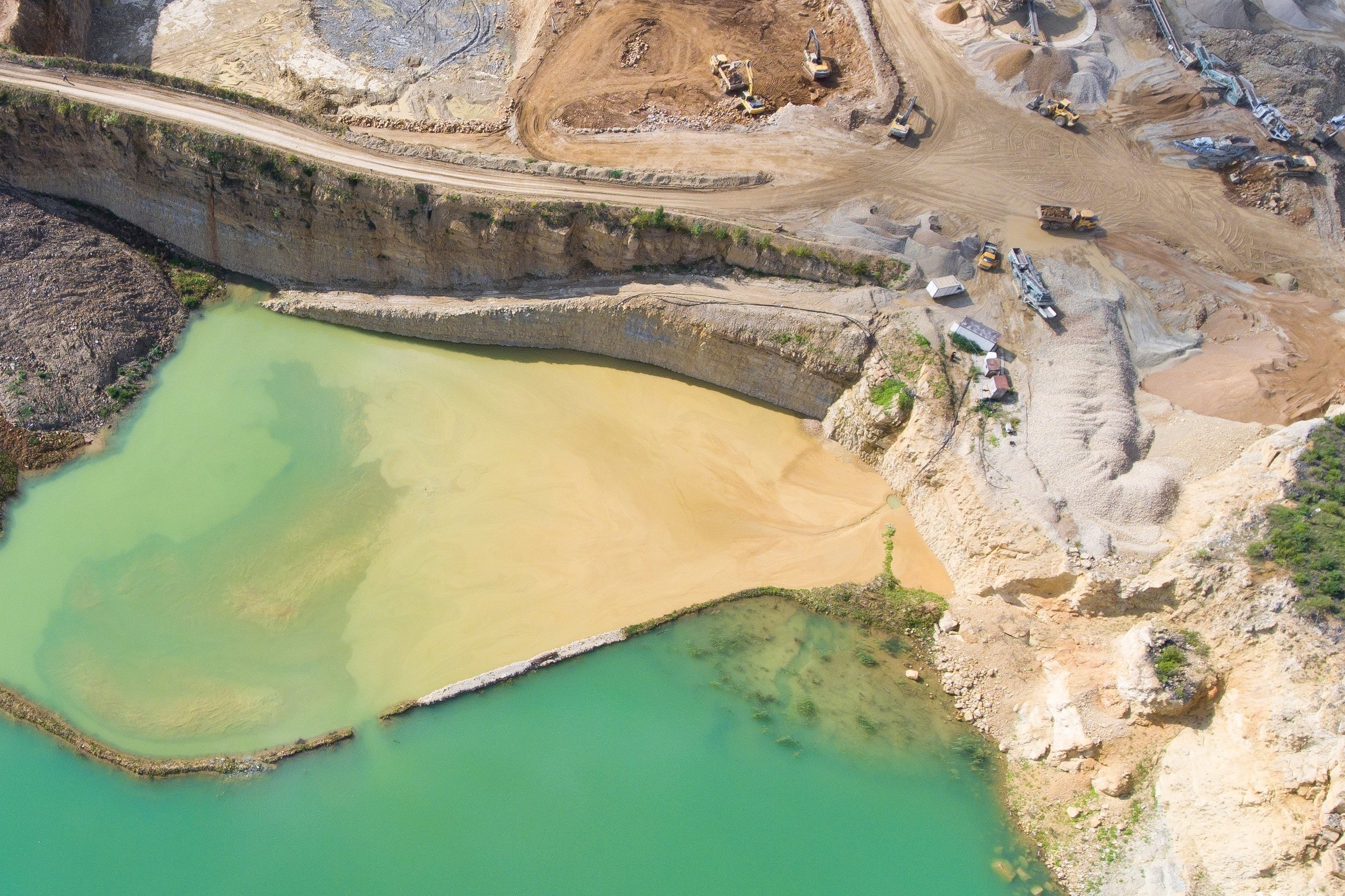 Mine Waste Storage - Thousands of tailings dams in current operation must be maintained indefinitely to avoid failure. Can geopolymer stabilization enable a better, safer alternative to tailings dams that require no long-term maintenance?