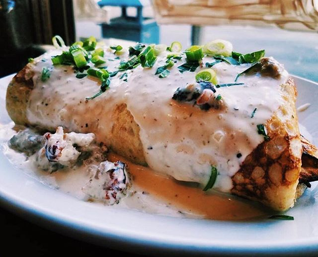 On the list of things we'd order purely because of the name.. this Country Bumpkin Crepe from @happycreekcoffee in Front Royal. Ham, cheddar, and egg filled crepe topped with warm sausage gravy. 😍 #vafoodie 📷: @happycreekcoffee