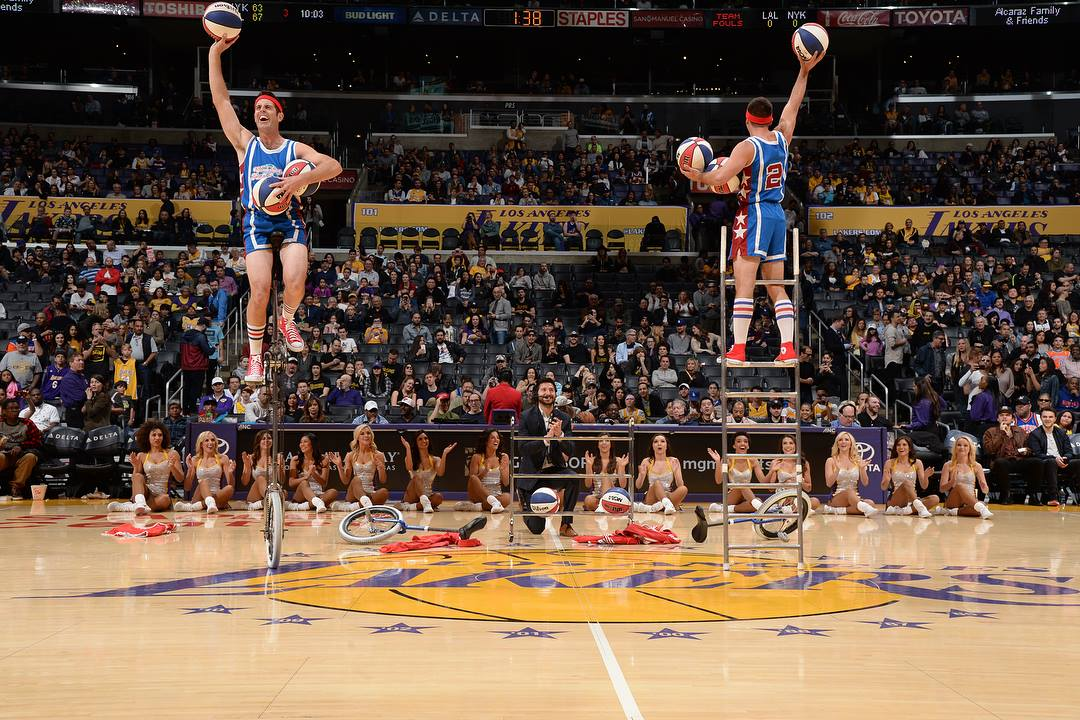 LA Lakers halftime show Mark on tall unicycle, Jon on a ladder