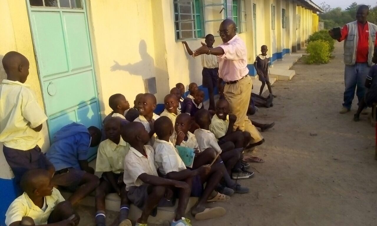 Co-Founder, Agandi Oyoo, meeting with students from Ranjira Primary School