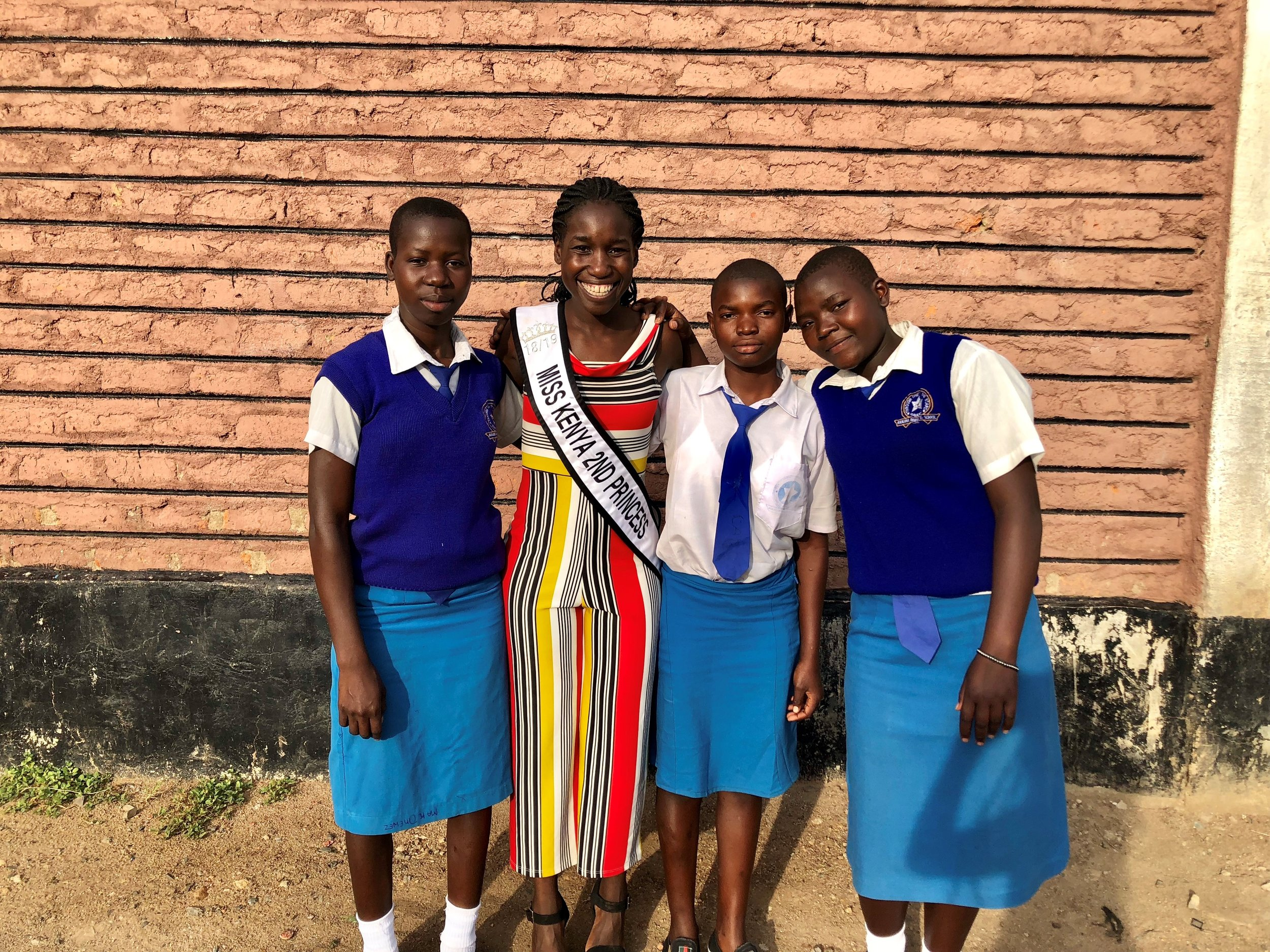 (L to R) Lydia, Caroline, and Violet all attend Ranjira Mixed Secondary Day School in Kisumu Kenya. Each of them are in Form 2 (Sophomore year). These young ladies were selected for the Kisumu Girls Empowerment and Health Scholarship based on academics, merit, and financial hardship. Each of them come from large families. When asked what this scholarship meant to them, they were all thankful and overjoyed. Caroline reiterated that her parents would not have to worry about her tuition and would be able to take care of the family while she focused on doing well in school.