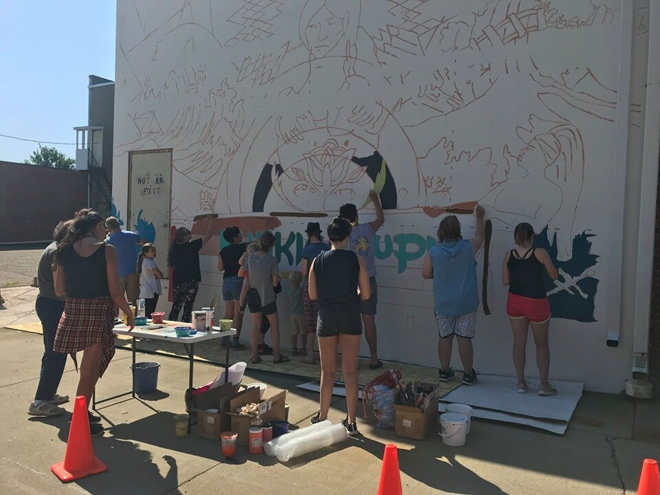 Members of the Vermillion community gather to pick up paint brushes and color in the lines. This community paint day was held in July 2019.