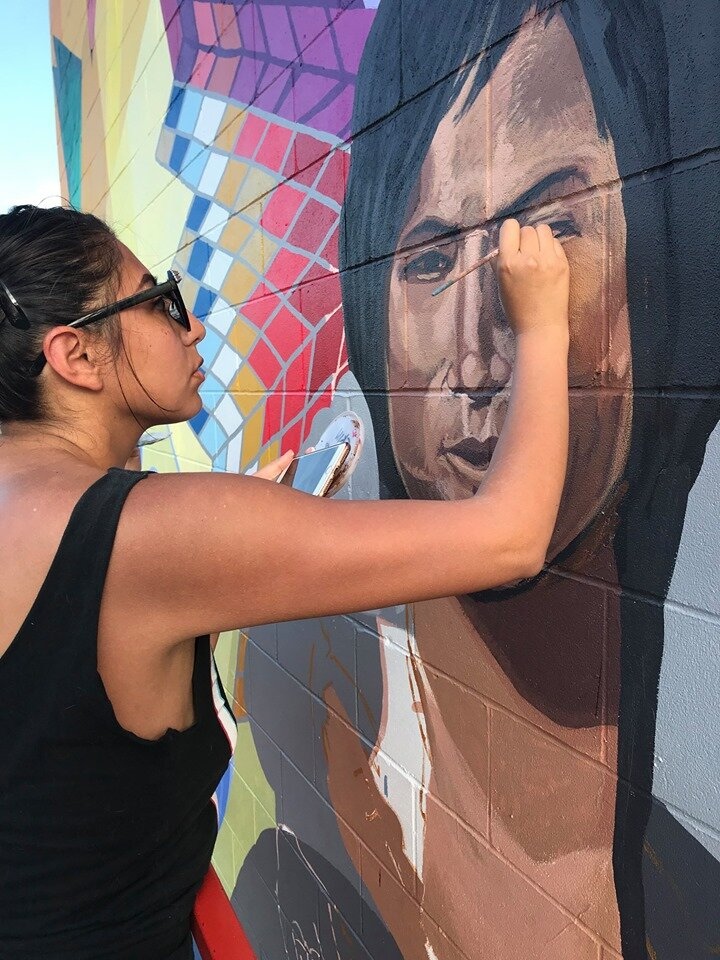 Reyna Hernandez brings the mural's central figure to life.