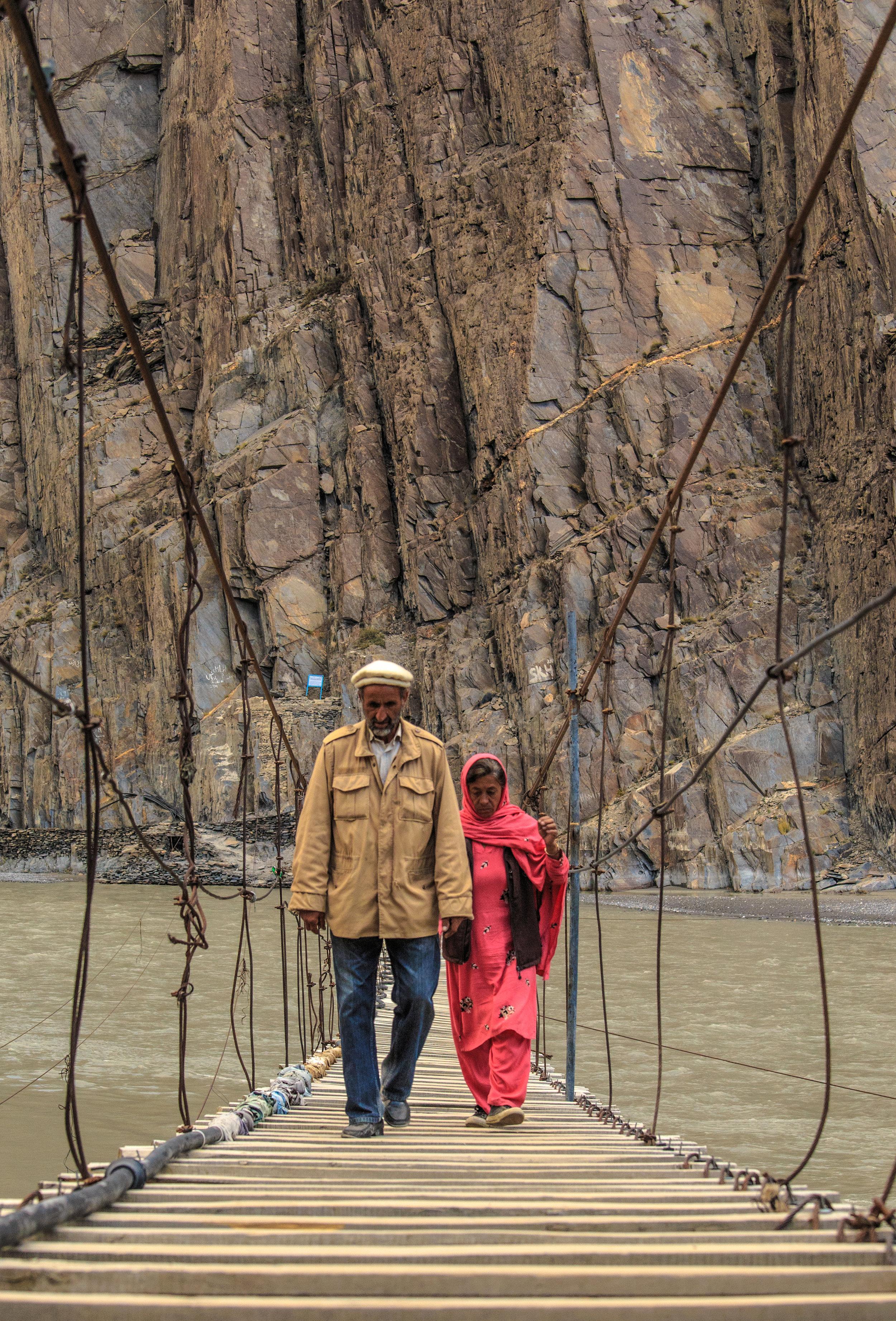 A couple crossing Husseini Bridge