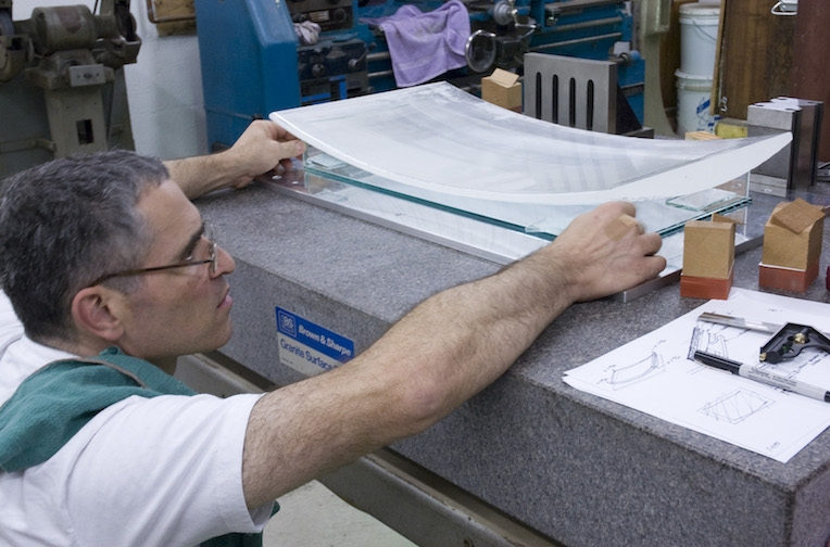 Positioning the bent casting blank for machining