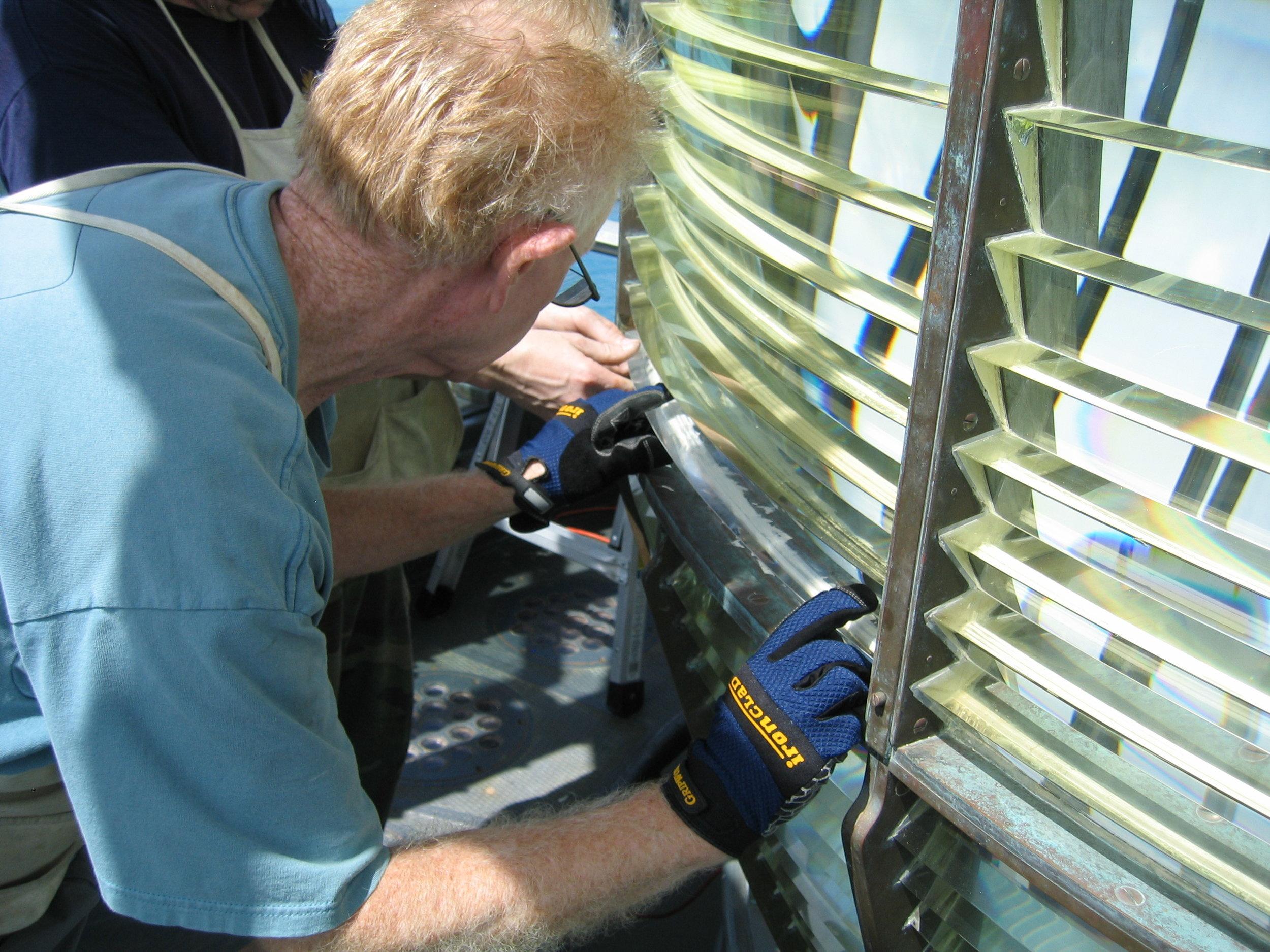 Onsite installation of Makapu'u prisms (photo courtesy of James Woodward)