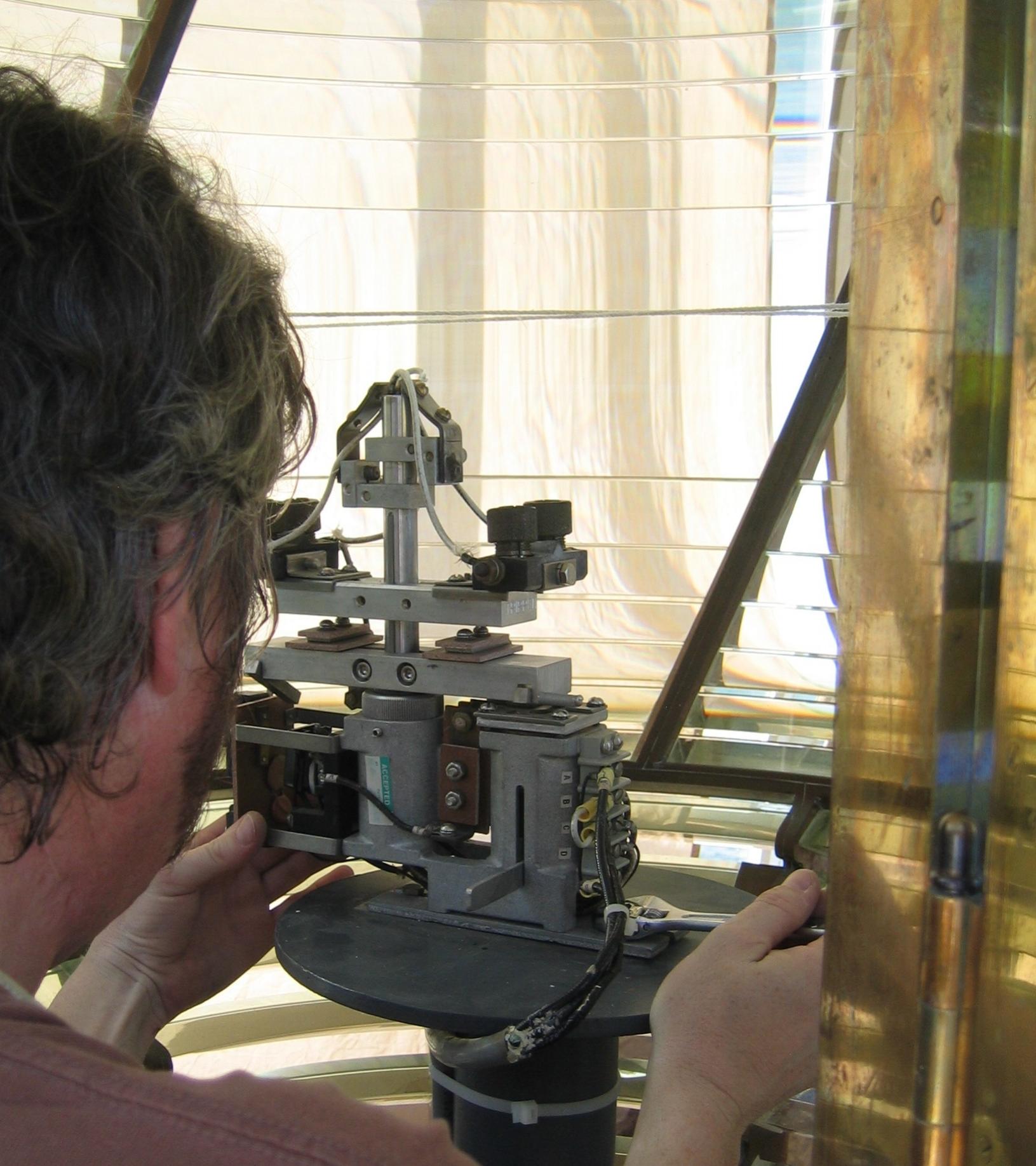 Onsite Makapu'u lens adjustments (photo courtesy of James Woodward)