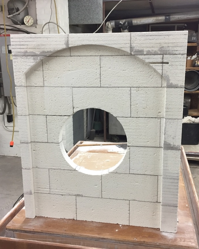 Carved brick glory hole front
