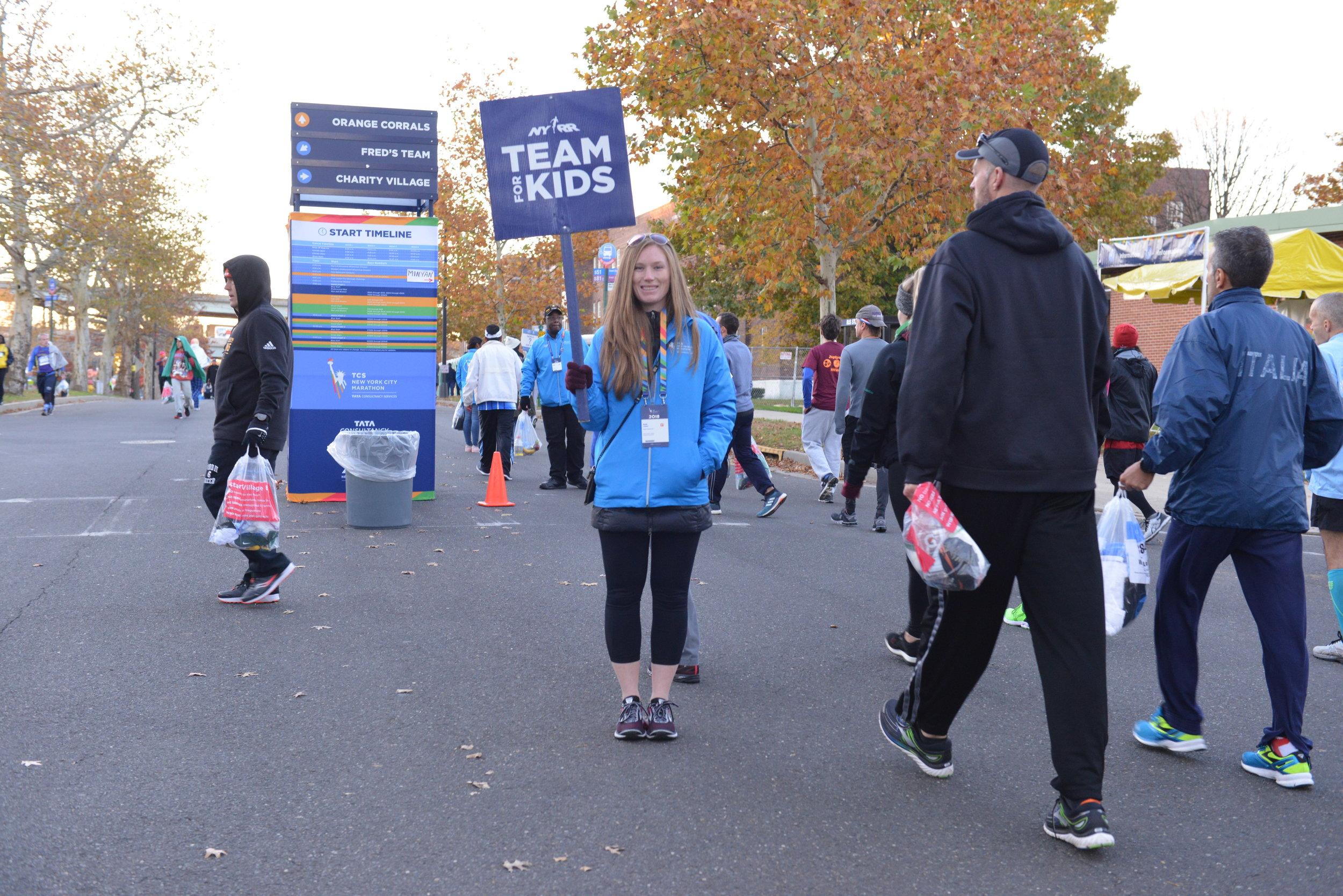 A volunteer at the TCS New York City Marathon start area.