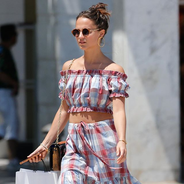 Alicia Vikander living out our @ullajohnson summer plaid dreams ✨🌺✨