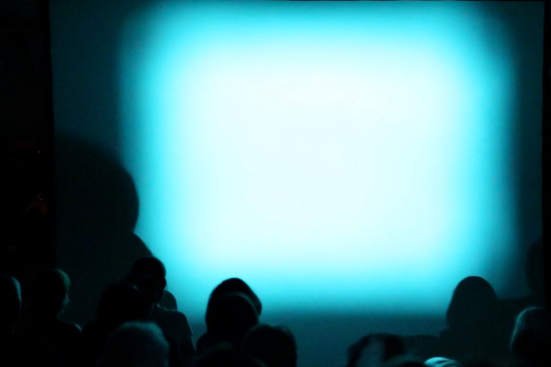 Light At The End Of The Tunnel - A cacophonic disruption threading horror and comedy into a live composition for phasing projection beams, voice and harsh light.