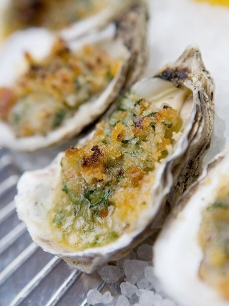 BBQ Oysters - Served piping hot and fresh off the grillWith creamy herb butter and crisp panko crumbs