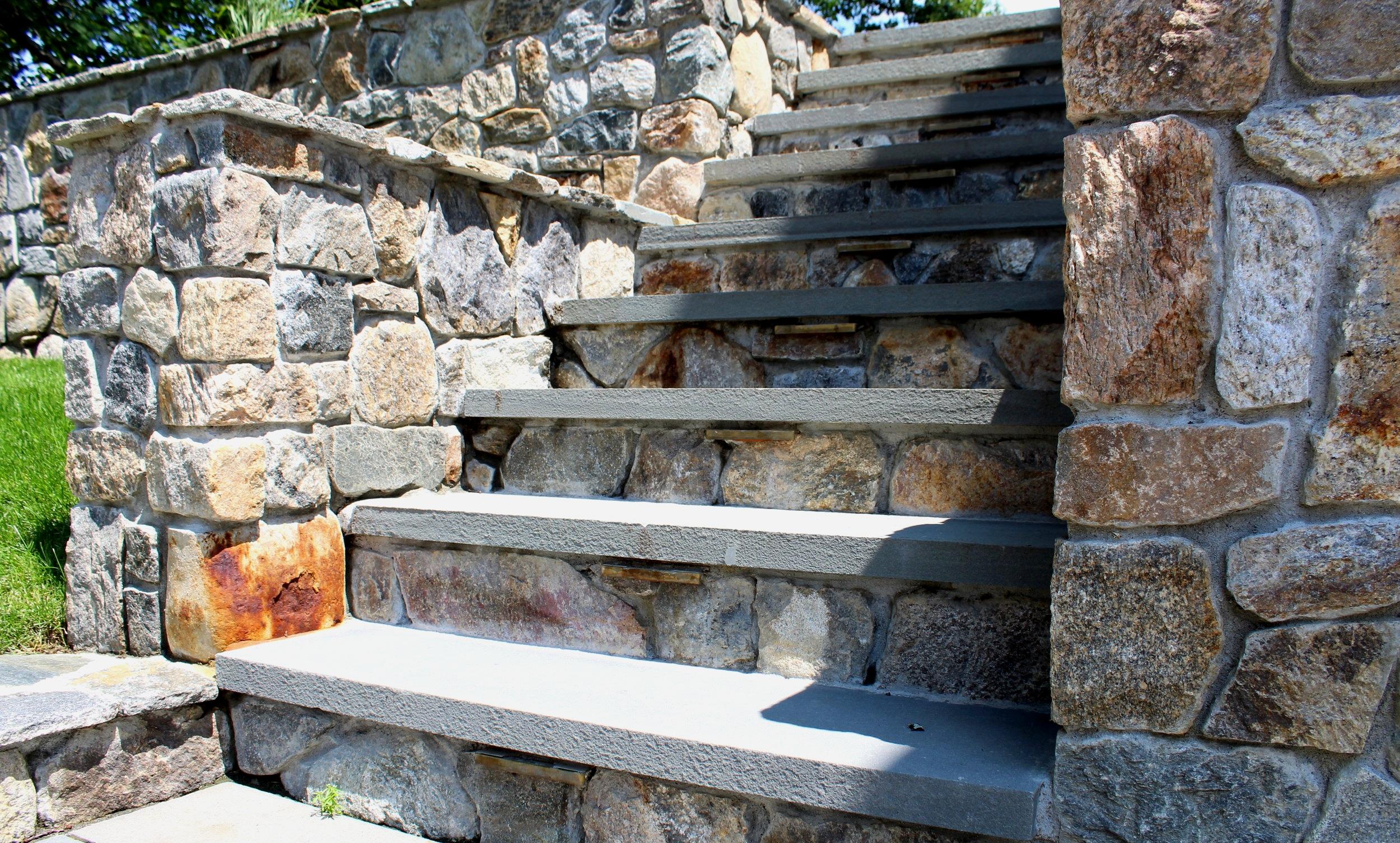 New england flat fieldstone wall with bluestone stair treads