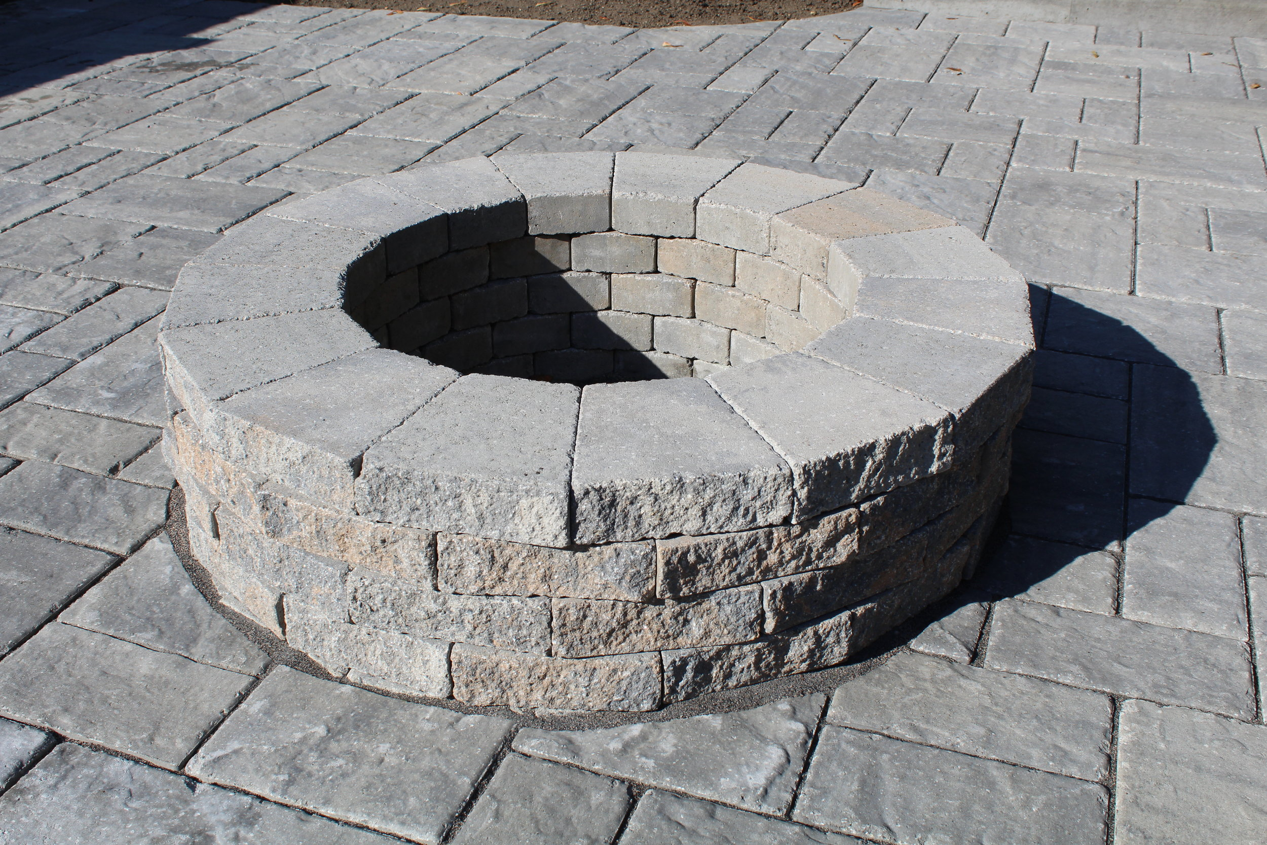 Techo Bloc Fire Pit and paver patio - blu 60 pavers