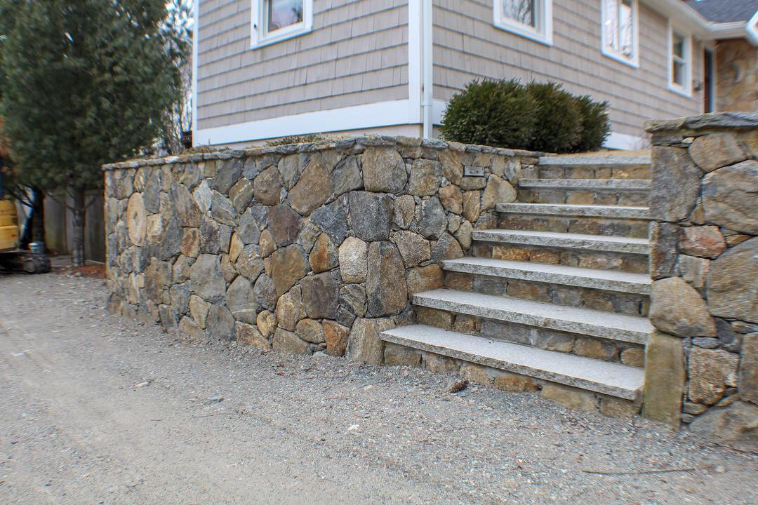 Fieldstone wall and steps with granite stair treads