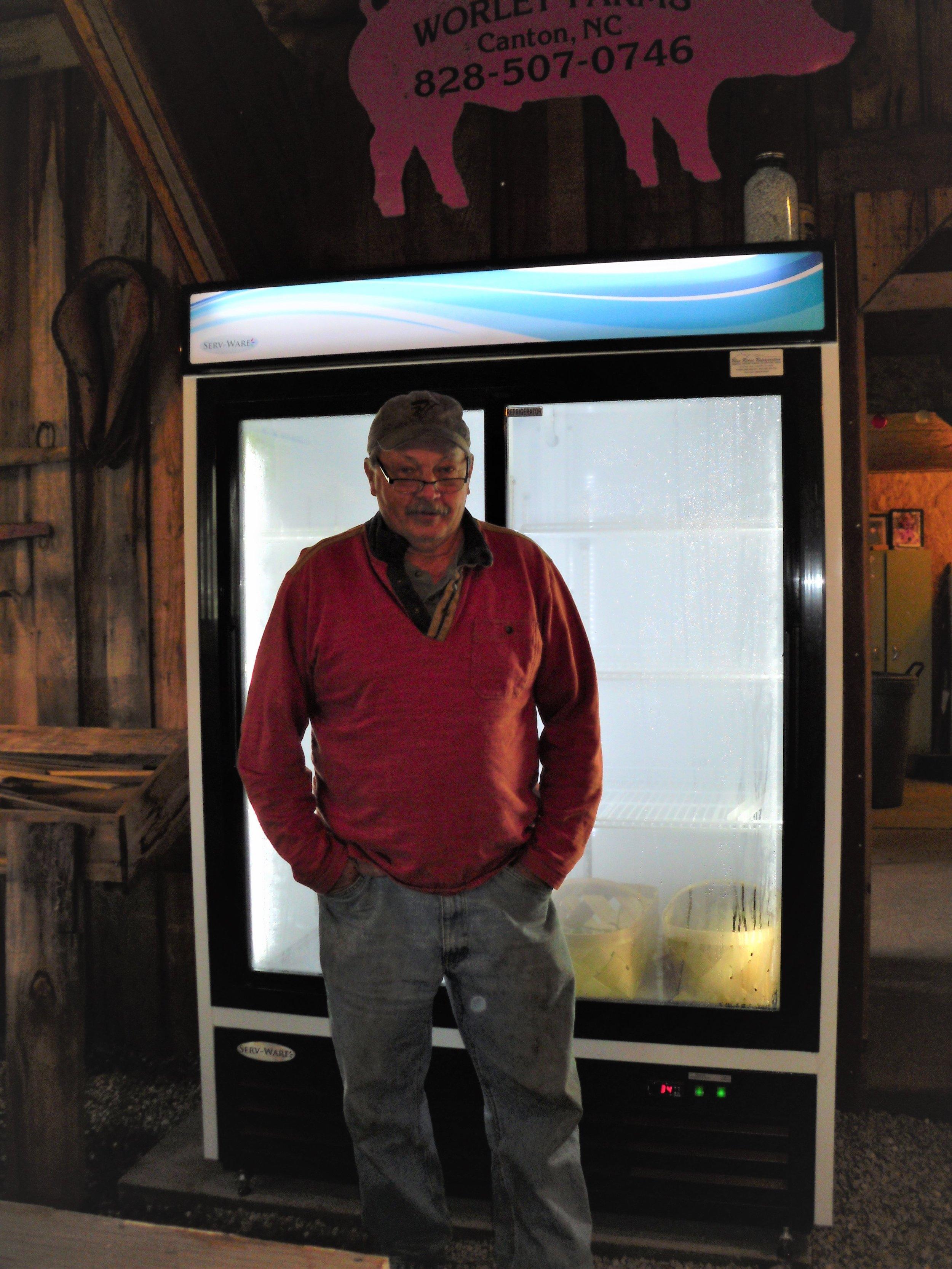 Danny Barrett, owner of Ten Acre Garden, standing proudly in front of his new restaurant-grade cooler.