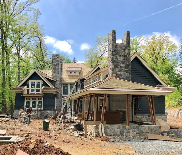Exterior is nearly complete on the @sek_architect designed shingle inspired home in #summitnj #luxurydesign #newhome #architecture #interiordesign #cedar #bluesky #spring @aiacnj #copper #stone #balcony @pellawindows #yankeegutters