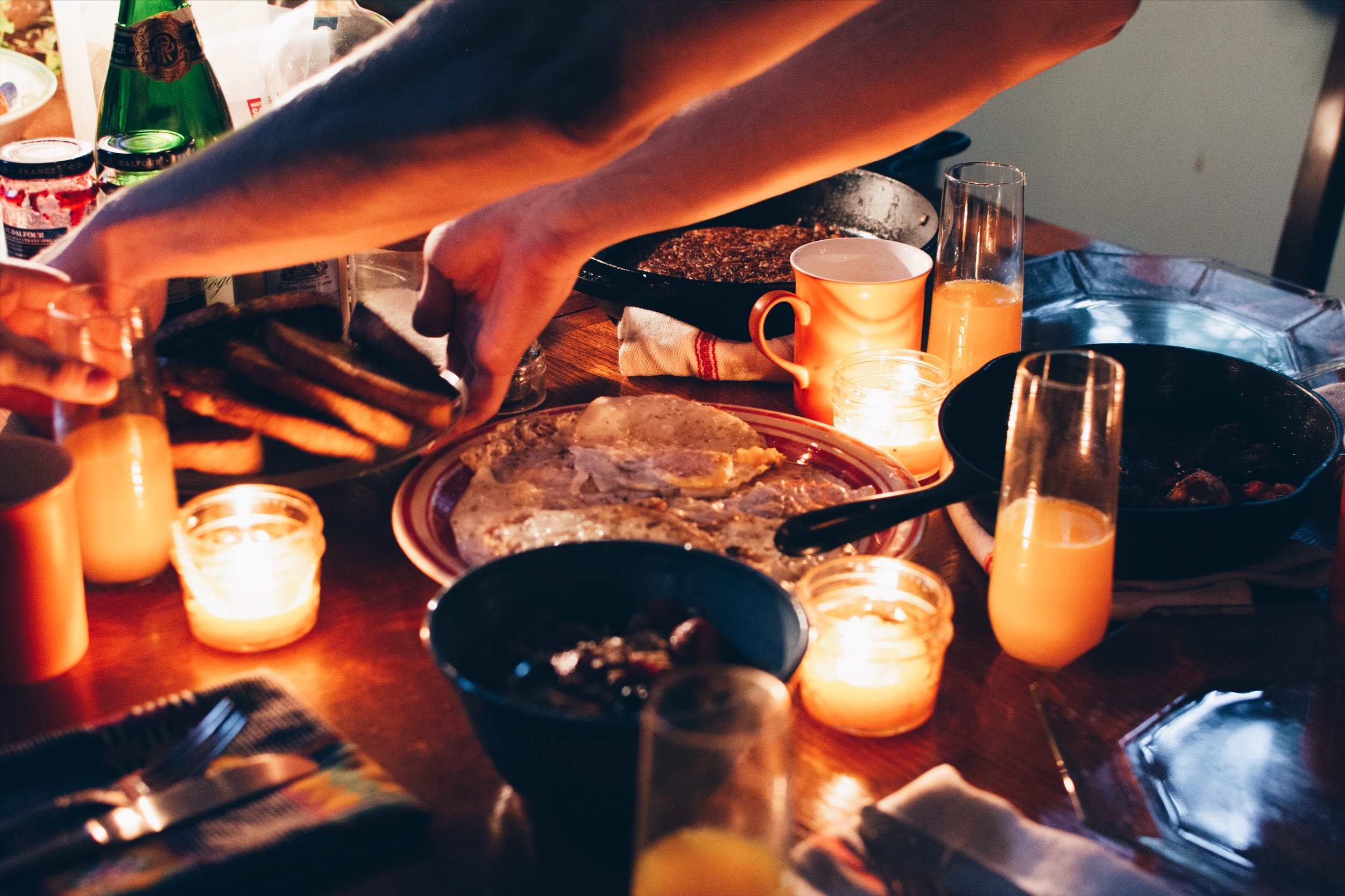 Send-off 5am breakfast for dear visiting friends: eggs, bacon, fruit, toast, hashbrowns, orange juice, coffee, beeswax candles.