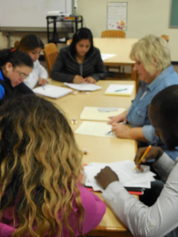 Sheryl Rajbhandari teaches parents English at the AWL school library.