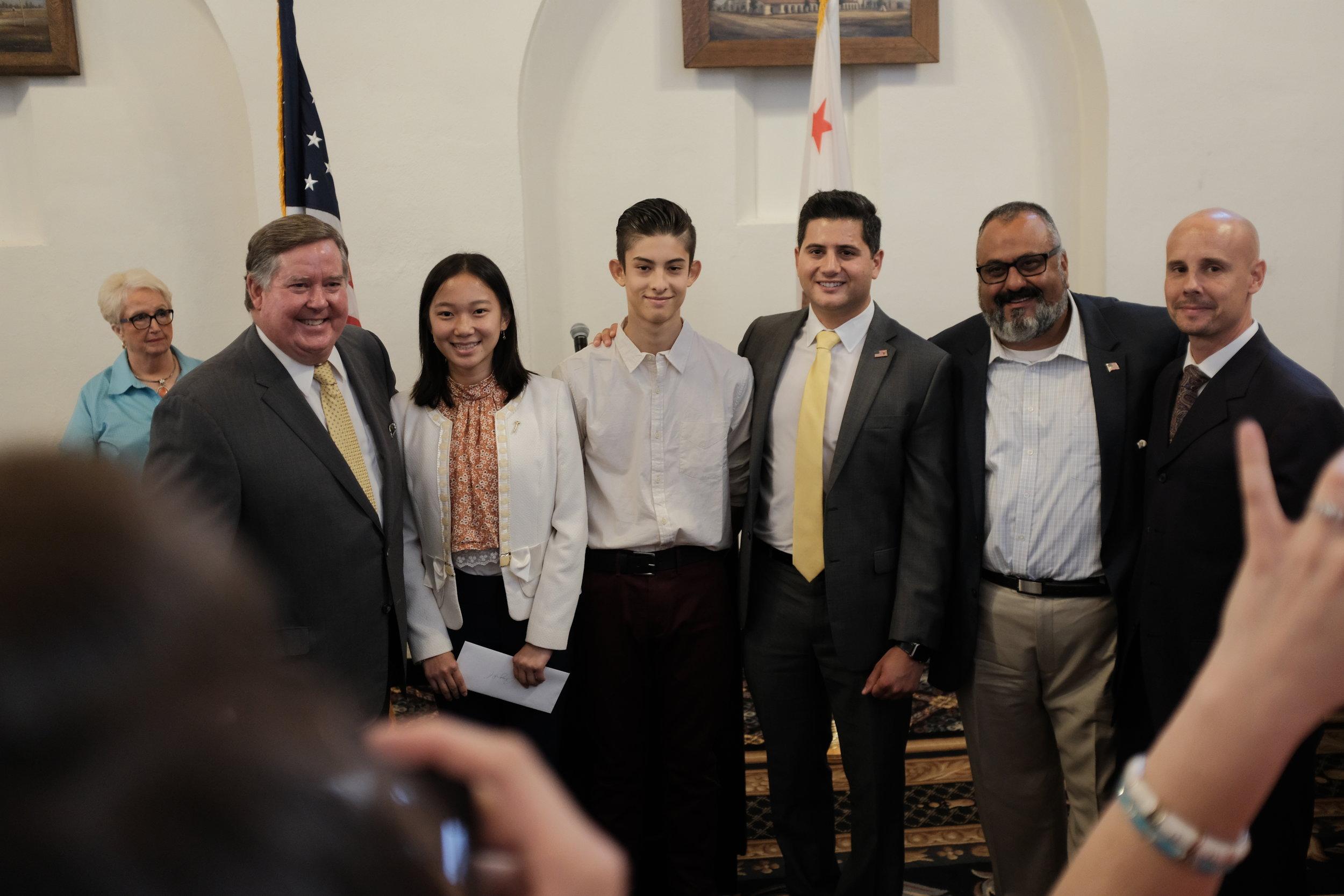 Congressman Ken Calvert, Bill Essayli, Ali Mazarei, and Ben Clymer speaking with motivated and involved High School students.